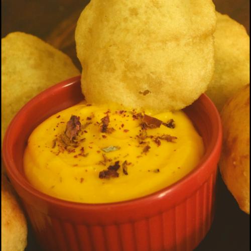 Mango shrikhand served with pooris